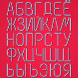 Blue Neon Cyrillic Letters On A Red Background Royalty Free Stock Image