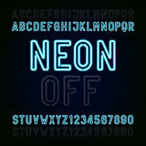 Blue Neon Light Alphabet Font. Two different styles. Lights on or off. Type letters and numbers. Stock Photos