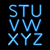 Blue neon light glowing letters set Stock Image
