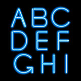 Blue neon light glowing letters set Stock Images