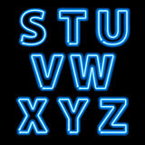 Blue neon light glowing letters set Royalty Free Stock Images