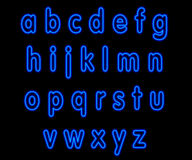 Blue neon lower case alphabet on black Royalty Free Stock Image