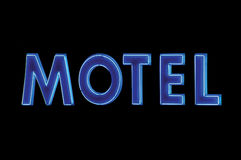 Blue neon motel sign lit up at night, isolated on black, large detailed horizontal signage closeup Royalty Free Stock Photography