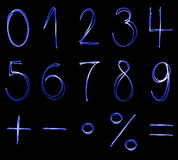 Blue neon numbers. Different flourescent numbers and math symbols in blue neon color Stock Photography