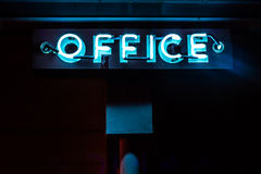 Blue Neon Office Sign Glows in the Night. Stock Image