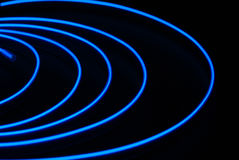Blue neon stripe. Is isolated on the black background Royalty Free Stock Image