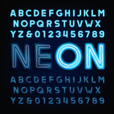Blue neon tube alphabet font. Light turn on and off. Stock Images