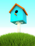 Blue nesting box in the grass Stock Photo
