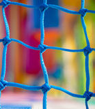 Blue net  in children playground. Focus on net Stock Image