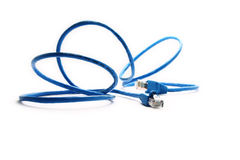 Blue network cable. Closeup blue network cable over a white background Royalty Free Stock Photography