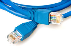 Blue network cable with jack. Closeup of blue network cable with jack isolated on white Stock Photo