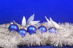 Blue New Year's balls  on a blue background Stock Image