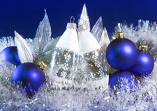 Blue New Year's balls and glass icicle on a blue background Royalty Free Stock Images