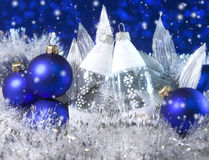 Blue New Year's balls and glass icicle on a blue background Stock Photo