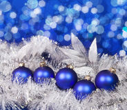 Blue New Year's balls and tinsel on a blue background Stock Images