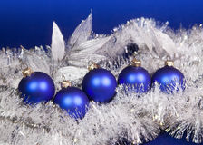Blue New Year's balls and tinsel on a blue background Stock Photo
