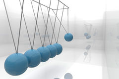 Blue newtons cradle Stock Photo