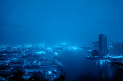Blue night city and river view Royalty Free Stock Image