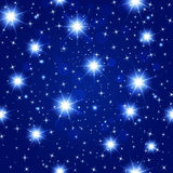 Blue night sky seamless pattern with glowing stars. Vector illustration Stock Images