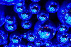 Blue nightclub disco balls. In colorful festive lights in dance club Royalty Free Stock Image