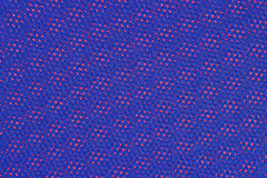 Blue nonwoven fabric on a red Stock Images