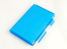 Blue nootbook and pen Stock Images