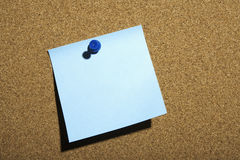 Blue Note Pinned on Board Royalty Free Stock Photo