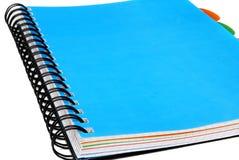 Blue notebook. Blue binder notebook on white background stock photo