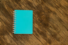 Blue notebook on the background of  old wood. Royalty Free Stock Photography