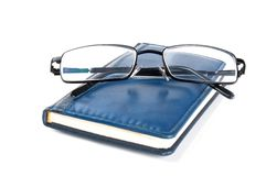 Blue notebook and glasses Royalty Free Stock Image