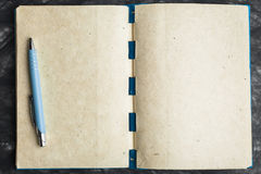 Notebook paper with the texture, and pen. Blue notebook paper with the texture and pen stock photos