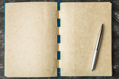 Notebook paper with the texture, and pen. Blue notebook paper with the texture and pen stock images