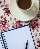 Blue notebook on table with pencil and coffee cup Royalty Free Stock Image