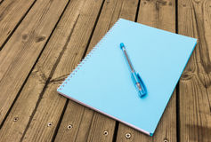 Blue notebook on wood Stock Image