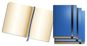 Blue notebooks in different sizes Royalty Free Stock Images
