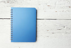 Blue notepad on white wood Royalty Free Stock Photos