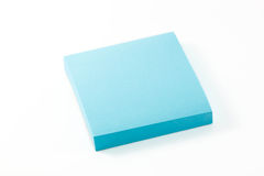 Blue notepaper on white background. Stock Photos