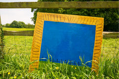 Blue noticeboard. In the middle of the meadow royalty free stock image