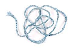 Blue nylon rope on white bacground. Entangled blue nylon rope isolated on white bacground Stock Photo