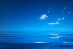 Blue ocean. With a sky and a few clouds Stock Photography