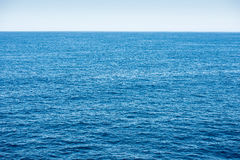 Blue ocean background with blue sky Royalty Free Stock Photo