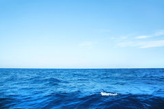Blue ocean background with horizon on the deep blue sea. Stock Images
