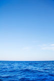 Blue ocean background with horizon on the deep blue sea. Royalty Free Stock Photos