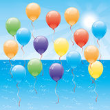 Blue ocean and balloons. Royalty Free Stock Photos