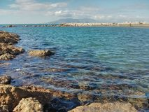 Blue ocean. Surrounded by rocks royalty free stock photo