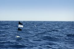 Blue ocean with fisherman longline flag Royalty Free Stock Image