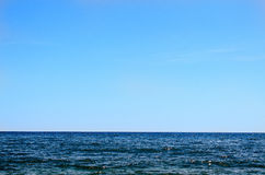 Blue Ocean with Flat Horizon and Blue Sky Stock Images