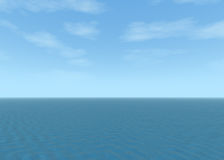 Blue ocean landscape with blue cloudy sky Royalty Free Stock Image