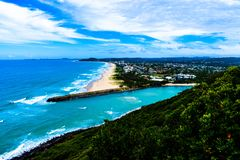 Blue Ocean Near Trees and Mountains Photo Royalty Free Stock Photos