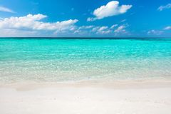 Blue ocean and sandy beach on Maldives stock image
